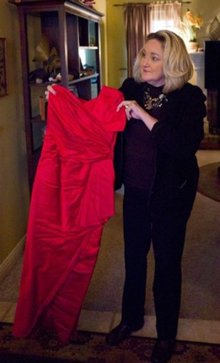 Burks holding Billy's red dress