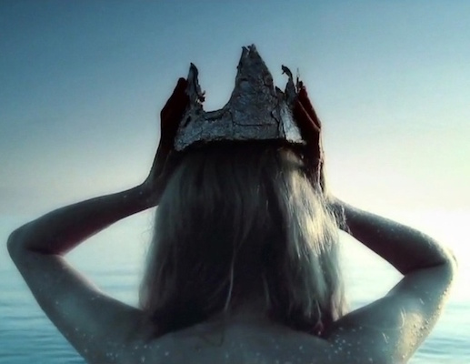 T - music video still, showing the Foil Crown